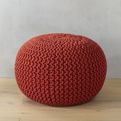 """knitted blood orange pouf / $79.95 at CB2 / 20"""" dia x 14""""H / hand knit textured cotton weave -- also in graphite gray and bright yellow"""