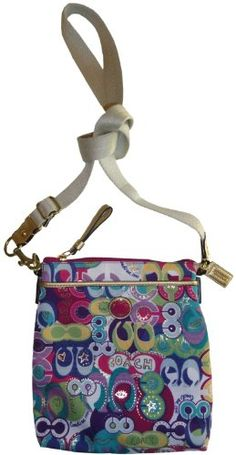 Coach Limited Edition Signature Poppy Swingpack - my favorite print! I've got the matching wallet..now I just need the bag! :)