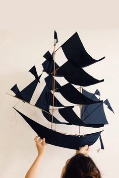 Get carried away with our SUPER sailing ship kites. Intricately hand-crafted by artisans in Bali, each indigo-colored kite is a...