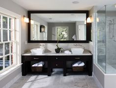 By Lori Shaffer Some Elements To Keep In Mind When Designing Your Double Vanity Are Symmetry Ample Counter Space Between Sinks A Large Mirror Spanning