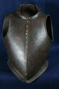 Italian cuiraass, 1580, full peasscod shape mimicing the doublet of the time. Formed in three pieces, one narrow one down the center of the back and two sides which join at the center of the front. The sections are secured by a pair of interior inset hinges in the lower portion of the back. Arm holes with outward turned roped rolls bordered by an engraved line. Neck and waist edges with inward turned finely roped rolls and bordered by single incised lines, 26 pounds 11.2 ounces (12.114 kg).