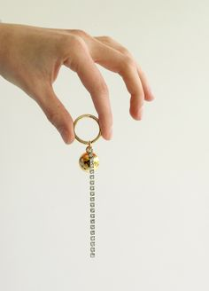 Material: brass, 18k gold plate, rhodium plate, swarovski, ccv / Size: length 13cm, drop 1.8cm, ring diameter 2.5cm