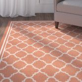 LOVE for under dining table, best option so far, would tie in the terra-cotta color in the blue rug