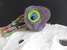 Items similar to Ver is a colourful, handmade, needle and wet felted puppet. She may look like a squid but really .she's a spaceship on Etsy Puppets, Parrot, My Etsy Shop, Ship, Bird, Handmade Gifts, Check, Animals, Color