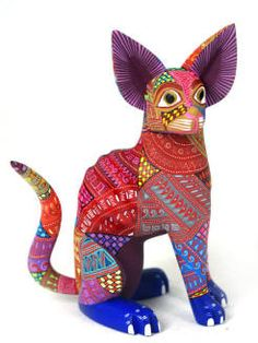 Alebrijes: Mexican Folk Art.     I did this project with Elementary aged students and they loved it.  It can either be done as a wood and glue project or ceramics.  Pattern, dot painting, and color should be emphasized.