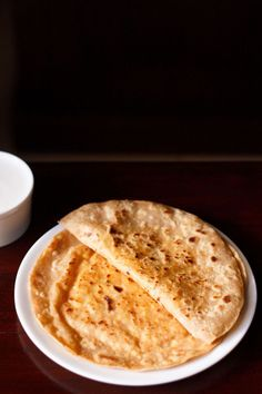 Paneer paratha is a popular North Indian flatbread made with whole wheat flour dough and stuffed with savory, spiced, grated paneer (Indian cottage cheese) stuffing. Paratha Recipes, Paneer Recipes, Veg Recipes, Curry Recipes, North Indian Recipes, Indian Food Recipes, Punjabi Recipes, How To Make Paneer, Paneer Dishes