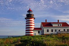 My favorite of many stunning Maine lighthouses, the West Quoddy Head Light (in Lubec), the first place to greet the sunrise in the contiguous United States.