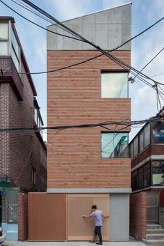 This cute house is standing in middle of old house town in Seoul, south Korea. Despite the house contains highly compressive function, we tried not. Brick Architecture, Minimalist Architecture, Interior Architecture, Compact House, Casas Containers, Narrow House, Tower House, Small Buildings, Brick Building