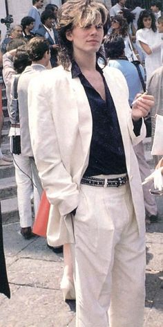 John Taylor of Duran Duran looking very in style with a white suit, oversized blazer with shoulder pads and the new wave version of the mullet.  Even with all that, very sexy.  ;-)