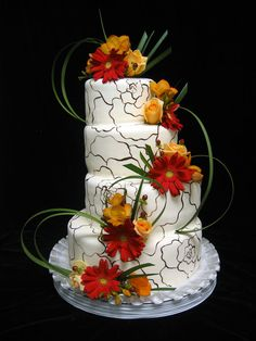 White cake with Fall colored flowers and roses hand drawn in background...