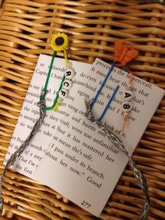 A little idea for bookmarks, using giant paper clips, beads which I put on using wire and some ribbon. As a personal touch I added initials on beads and tied them to the top. Displayed on photocopied book passages glued to card because I didn't have the heart to rip real book pages out!