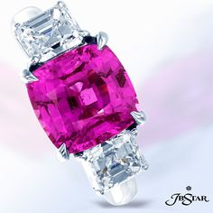 By JB Star, this three-stone platinum ring features a gorgeous square cushion-cut 4.27 ct. sapphire of a lovely and feminine pink shade, flanked by 1.82 ct. square-emerald-cut diamonds. A head-turning masterpiece for a bold lady! www.diamonds.pro
