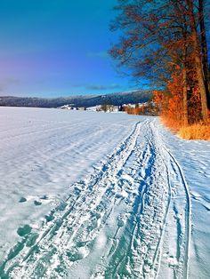 Hiking through a sunny winter scenery. Aigen-Schlägl, Austria / Österreich