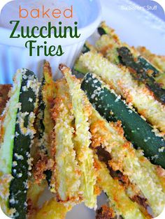 Baked Zucchini Fries Recipe on MyRecipeMagic.comIngredients  1/2    cup    bread crumbs, plain ( Panko brand )  1/4    cup    parmesan cheese, grated ( (the crumbly kind, not shredded) )  2    eggs  1    pound    zucchini squash ( (I used 3 medium sized zucchinis) )   Directions  Preheat oven to 425. Line a baking sheet with aluminum foil and spray with non-stick cooking spray. Set aside. Combine bread crumbs and Parmesan cheese.