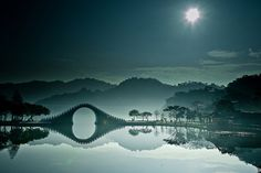 The Moon Bridge, in DaHu (Big Lake) Park in Taipei, northern Taiwan. The park itself in fact sits close to the industrial centre of Taiwan. The northern Neihu district of Taipei is famous for its IT industry and large shopping complexes.