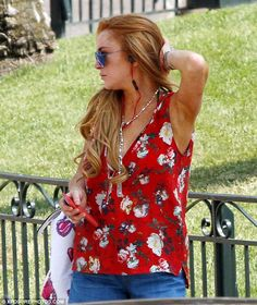 In her own world: Lohan blocked out the noise from the streets with a set of headphones...