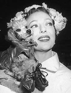 HOLLYWOOD, CIRCA 1955 -- Actress Loretta Young (1913-2000) holds her pet poodle Pierre on her shoulder.