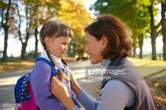 Stock Photo : Mother and Daughter Waiting for School Bus