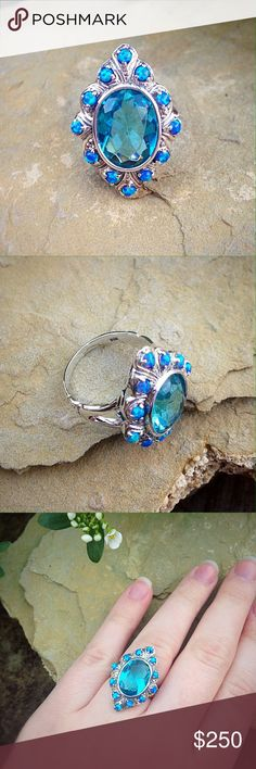 Antique sterling silver blue topaz & opal ring Absolutely gorgeous blue topaz and opal in a solid sterling silver setting. Jewelry Rings