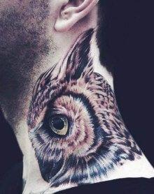 Tattoo neck owl green eyes