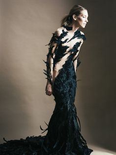 black feathered gown by Michelle Hébert, photo by Jamie Beck