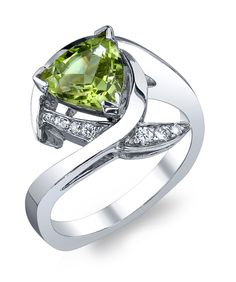 14k white gold peridot trillion ring accented with 0.07ctw diamonds.This piece may be reproduced in the gemstone of your choice. Please allow additional time to source stones.