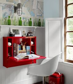 Bright Red  In this North Carolina home, a bedroom's office area gets pops of color from vintage soda bottles and a fire engine red wall-mounted desk. The Eames-style chair was a garage sale find.