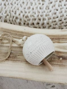 Ceramic bell wall hanging Round x Stoneware Bell, White w/ Wood Bead Ceramic Tableware, Stoneware Mugs, Ceramic Pottery, Ceramic Art, Slab Pottery, Thrown Pottery, Ceramic Beads, Earthenware, Beginner Pottery