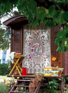 Lace curtain embellished with crochet flowers roulotte jeanne bayol gypsy caravan