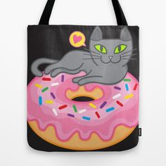 My cat loves donuts / doughnuts and surprises. kitten / kitty / cats / meow / kawaii / neko /gatto / gato / gatti / katze / chat / yummy / sweet tooth / pastry / dessert / sweet treat / yellow color / grey cat / gray cat / icing / frosting