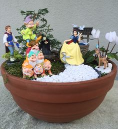 I created this Snow White miniature garden for my niece who will be celebrating a birthday very soon!  My niece and her family love the Disney classics and Snow White was at the forefront of my niece's list and in the forefront of this miniature garden.  4/2016