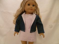A denim rhinestone blazer with a pretty lavender sheath dress for American Girl dolls. A wonderful spring dress to add to your dolls wardrobe! This chic sleeveless sheath dress was made with a lavender flower pattern cotton. It is fully lined with white muslin. The back of the dress