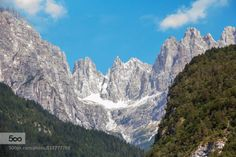 The rocks by alexroeggla  Mountains beautiful blue clouds forest green italy sky stones summer sun travel trees The rocks alex
