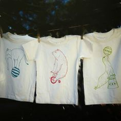 It's never too early to introduce baby to the greatest show on earth. This crewneck tee set features hand-drawn illustrations of three under-the-big-top favorites, including a green Seal Juggling a Ball on Its Nose, a blue Elephant on a Ball and a red Bear on a Bike. Each is screen-printed—using the highest quality eco-friendly fabric inks—on an incredibly soft 100% organic cotton American Apparel brand tee. Any slight variations in color and placement make each one-of-a-kind.
