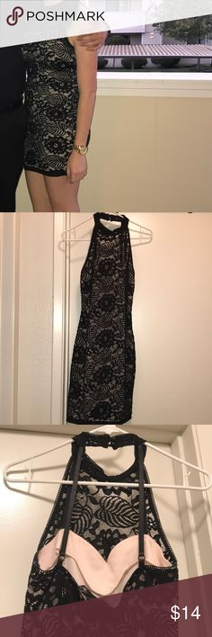 Black lace short dress Black lace dress. Only worn one time! It is a size medium but it fits like a small. Has cream undertone under the black lace Dresses Mini