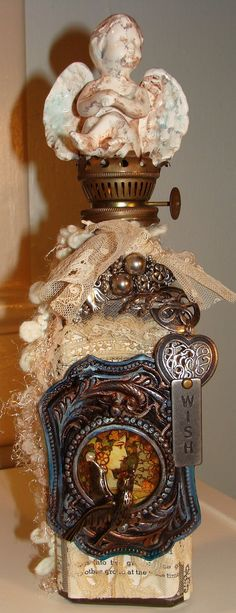 Altered Art Bottle. So beautiful !! Love the little angle on/and the Lamp...'thing':) !