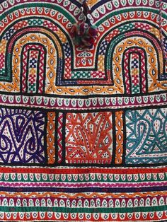Vintage hand embroidered Rabari dowry bag with tassels. Gujarat, India.