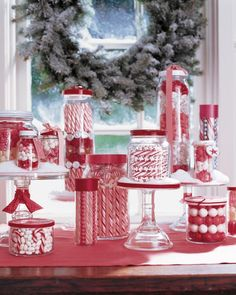 When setting out jars or bowls of treats for your holiday displays, fill the majority of the container with household objects to save on cost. Place cans in the core of a container or towels in the bottom of a bowl, and then cover with candy, walnuts, or ornaments.