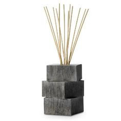 """Stackable Reed Diffuser Holder Item #:  P90617 Three earthy, rustic wooden cubes stack to house an entire 4.5 fl. oz. (133 mL) bottle of fragrance oil, sold separately. 5¼"""" (13 cm) h, 3¼"""" (8 cm) w.  ~ Sale Price:  $10.00"""