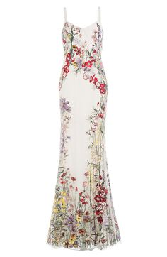From Alexander McQueen - an exquisitely Hand Embroidered Tulle Gown. A Classic Fitted Silhouette executed In White Mult-Floral Embroiderd Tulle over Taffeta. This is arguably the Summer Gown of the Year. For The Summer Event of the Year, bring out your best - in this case - Rubies and Red Satin Sandals (All on this board) Enjoy! - Gabrielle