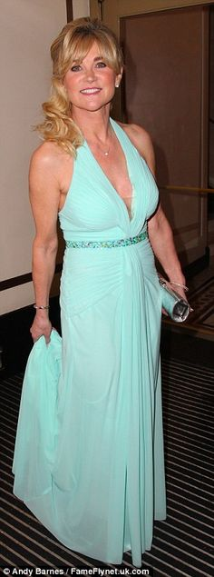 Val-hun-tine's Day: Anthea Turner was suitably sassy in a turquoise ball gown which looked...