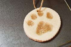 Turn your dogs' paws into cute Christmas decorations with our paw print Christmas craft! Makes a great homemade gift idea too!