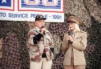 Entertainers Bob Hope and Ann Jillian perform for military personnel at the USO Christmas Tour during Operation Desert Shield., 12/01/1990