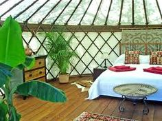 Yurt - beautiful bohemian green open bedroom with a delicious organic vibe