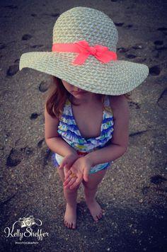Beach girl big hat shells