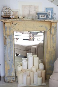 Faux Fireplace - I love the idea of candles in a fireplace when its not being used otherwise, gives visual interest to the space and takes care of having an ugly gaping black hole in your living room