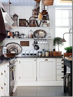 I love white kitchens with open shelves. A little too much clutter for me in this pic.