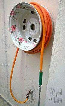 Tire Rim Hose Holder  ~  The last owners left a couple of wheels behind, maybe this is a use for them.