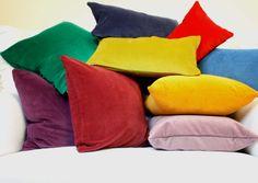 An assortment of colorful velvet pillows available at STUDIO TULLIA www.etsy.com/shop/studiotullia