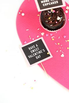 Chocolate cupcakes with Free Printable Valentine Cupcake Toppers - mini pink letterboards! Have a Sweet Valentine's Day and I Love You More Than Cupcakes Phrases